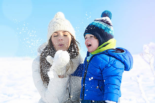 Babyboy son and mother are happy together, winter day stock photo