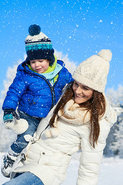 Babyboy son and mother are happy together - winter day stock photo