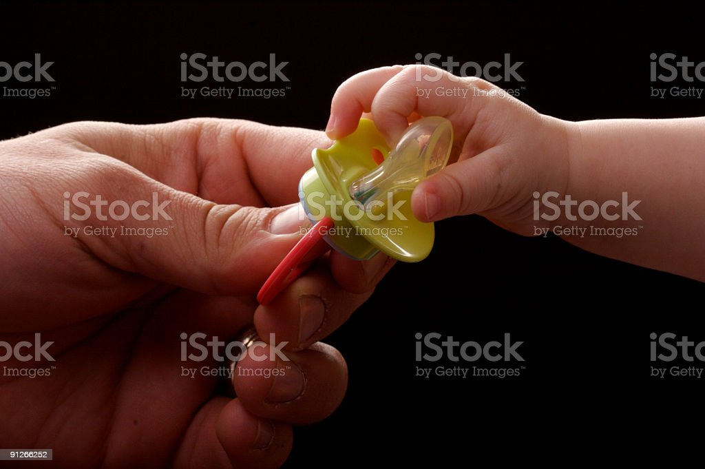 baby's and father's hand stock photo