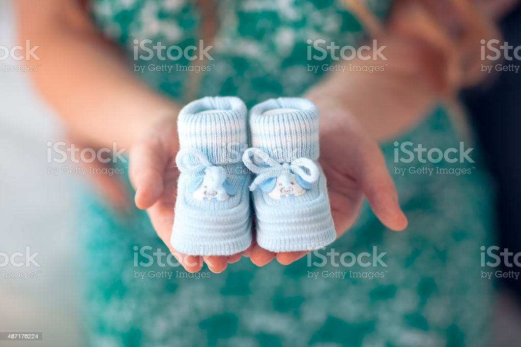 baby's bootees stock photo