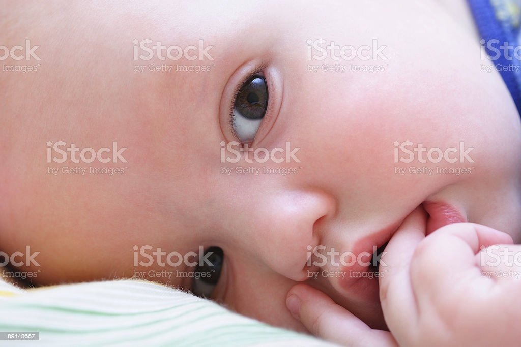 Baby's face looks at camera close up royalty-free stock photo