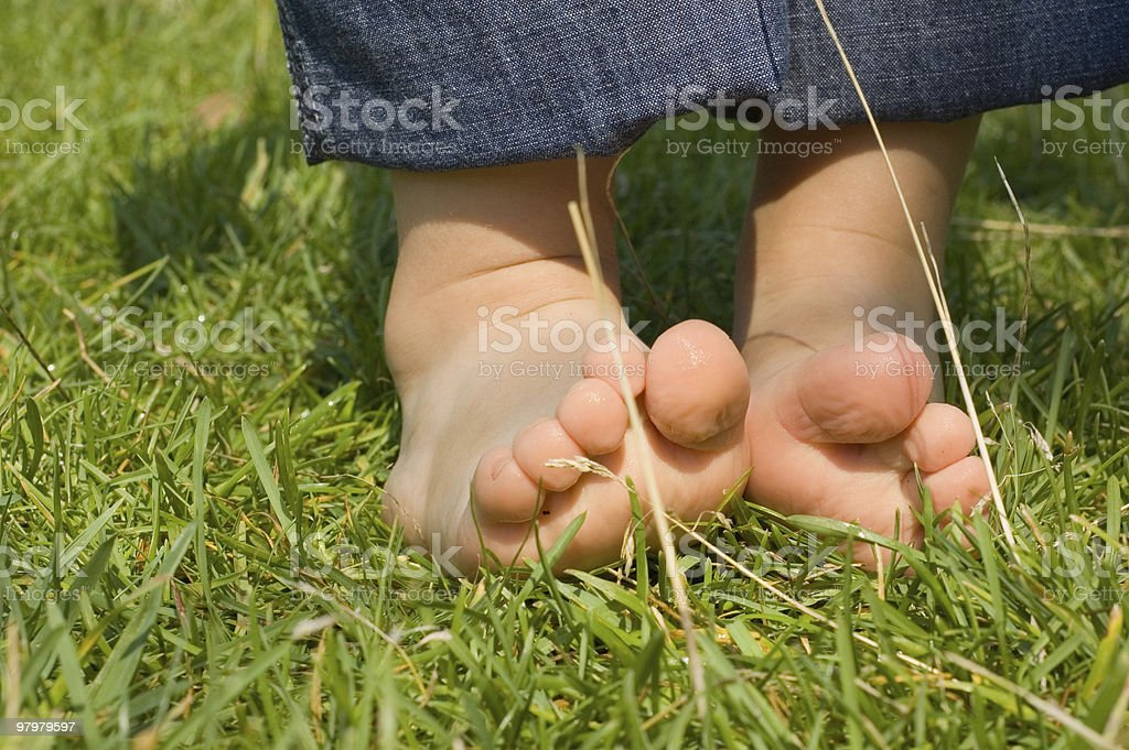 baby's feet on a green grass royalty-free stock photo