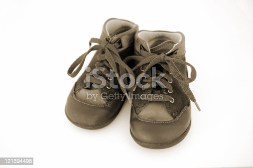 Pair of small brown baby booties. Isolated on a white background.