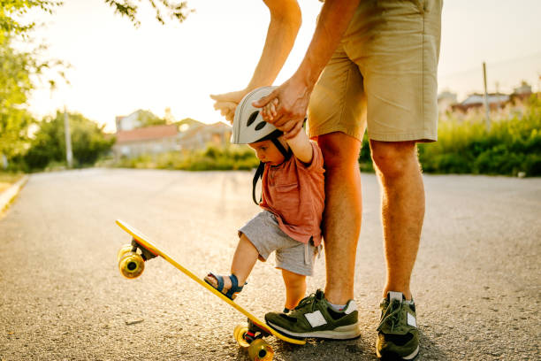 Baby's first skateboard ride stock photo