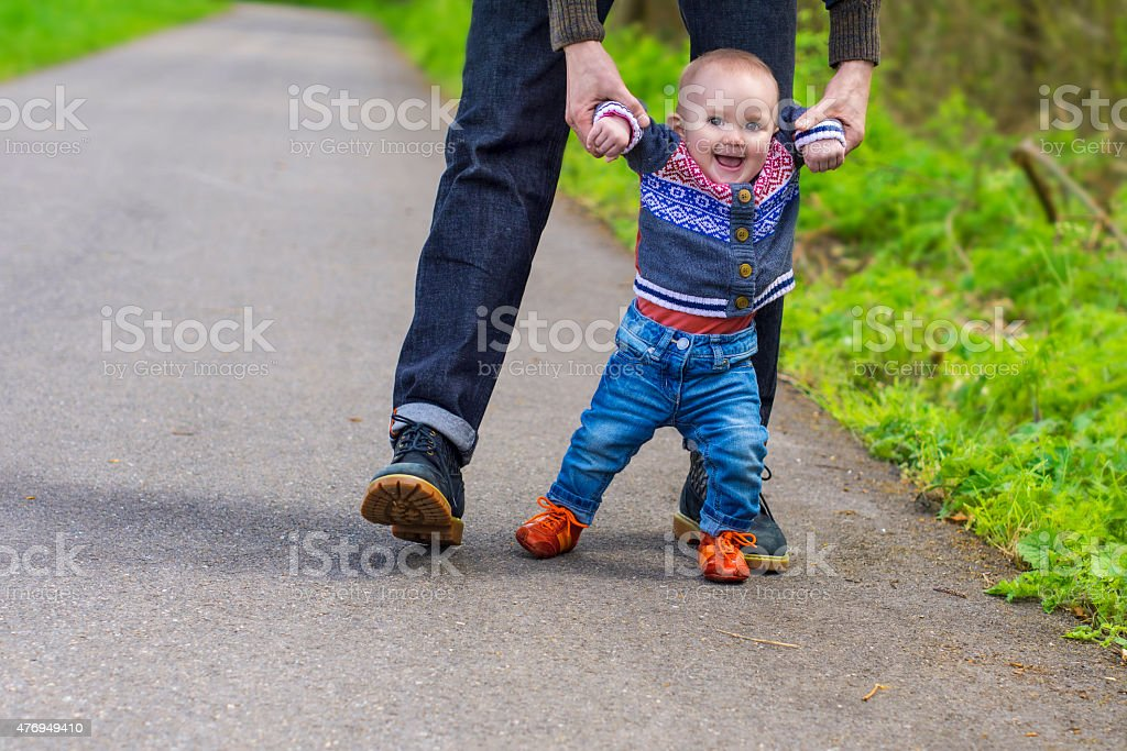 Baby's first steps stock photo