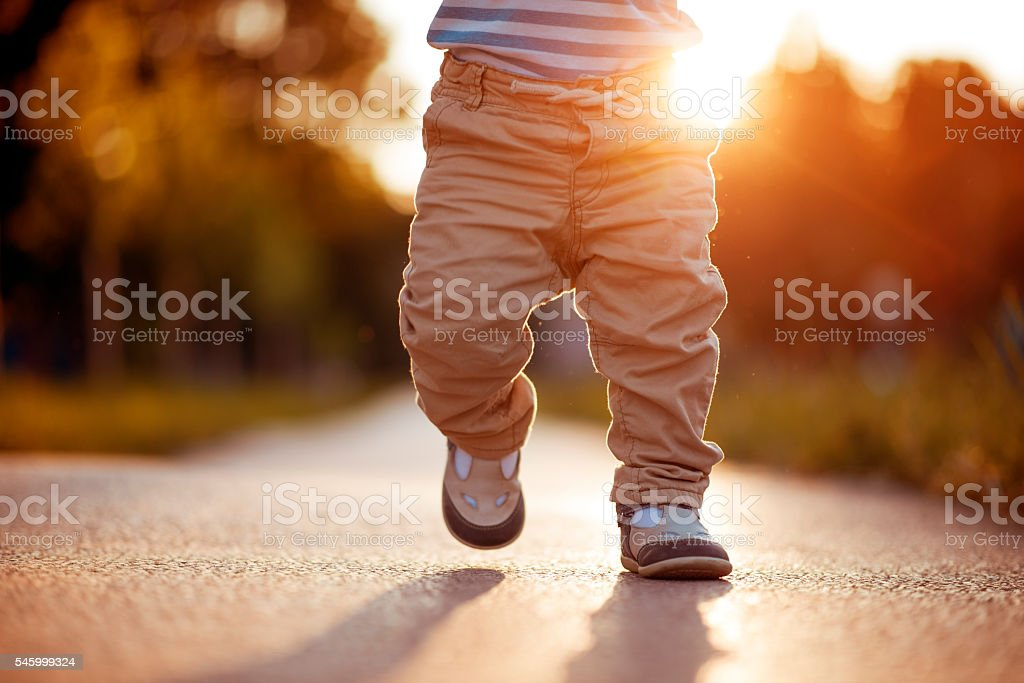 Baby's first steps royalty-free stock photo