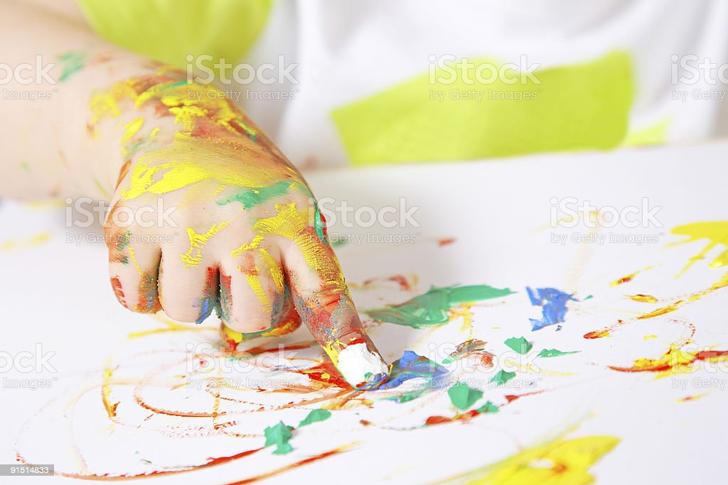 Baby's hand covered in paint while finger painting royalty-free stock photo