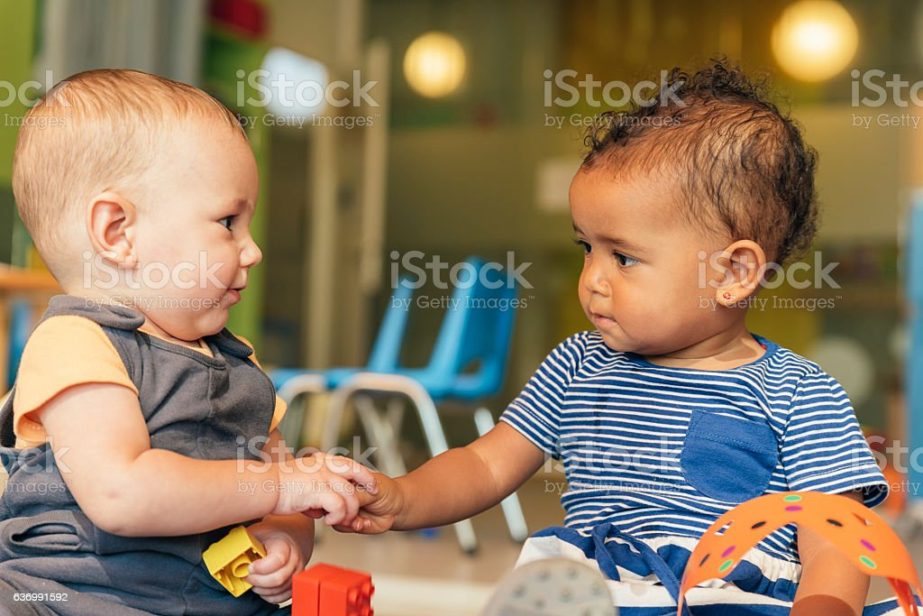Babys playing together. royalty-free stock photo