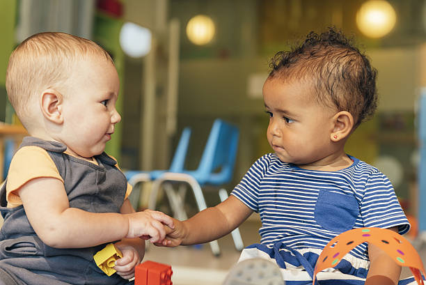 Babys playing together. stock photo