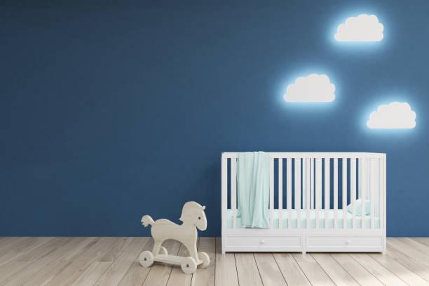 babys zimmer, blaue wände - pferde schlafzimmer stock-fotos und bilder