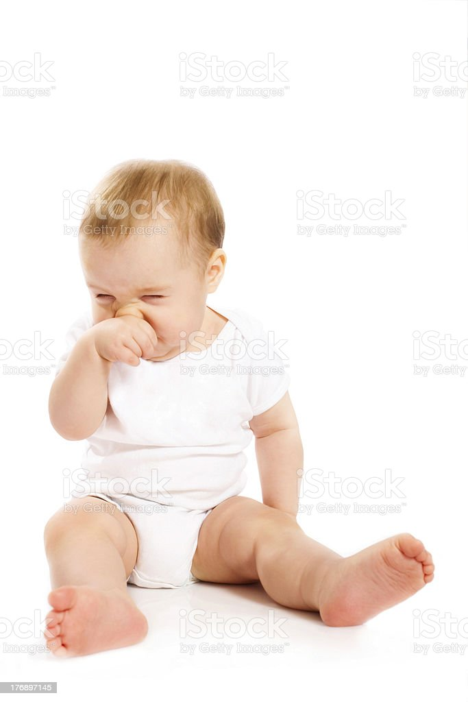 Baby's scratching his nose royalty-free stock photo
