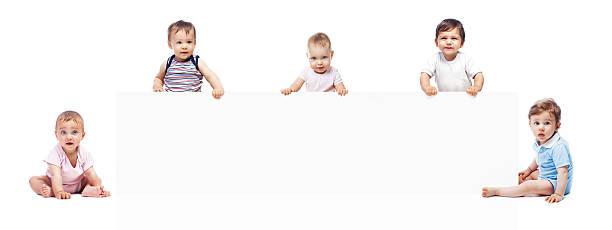 babys mit banner - sprüche kinderlachen stock-fotos und bilder