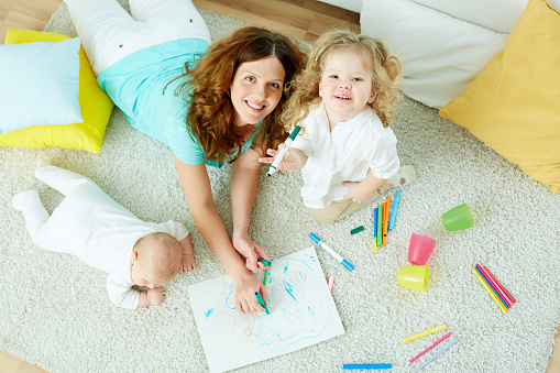 Babysitter With Kids Stock Photo - Download Image Now
