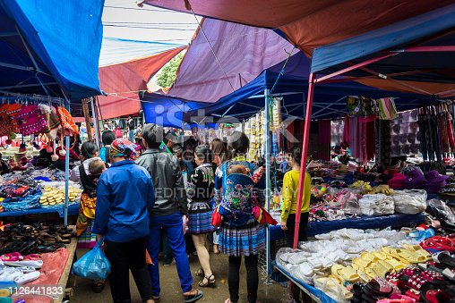 People shopping at the Colourful Bac Ha Sunday Market in the Flower Hmong ethnic minority village in Northern Vietnam