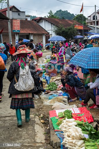 Sellers and buyers at the Vegetable market at the Colourful Bac Ha Sunday Market in the Flower Hmong minority village in Northern Vietnam