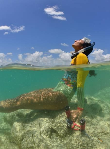 bacalar lagoon discoveries - woman leg beach pov stock photos and pictures
