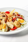 cod with garbanzo beans , peppers and eggs