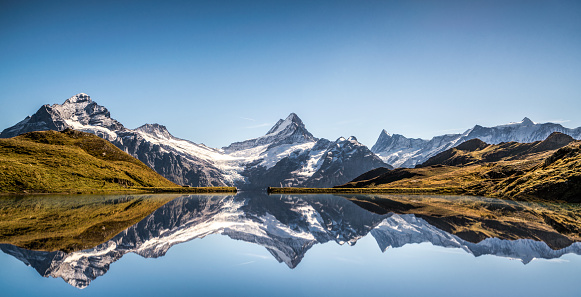 Lake Bachalpsee with reflecting Mountain, Schreckhorn, Finsteraarhorn, Grindelwald, Alps, Berne, Switzerland