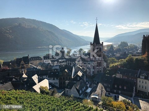 Landscape shot of German village with a church and river in the background