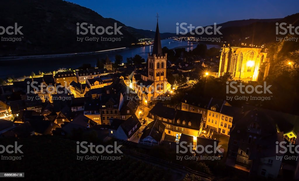 Bacharach, Rhine valley, Germany. City Panorama view with Rhine river and vineyard at night royalty-free stock photo