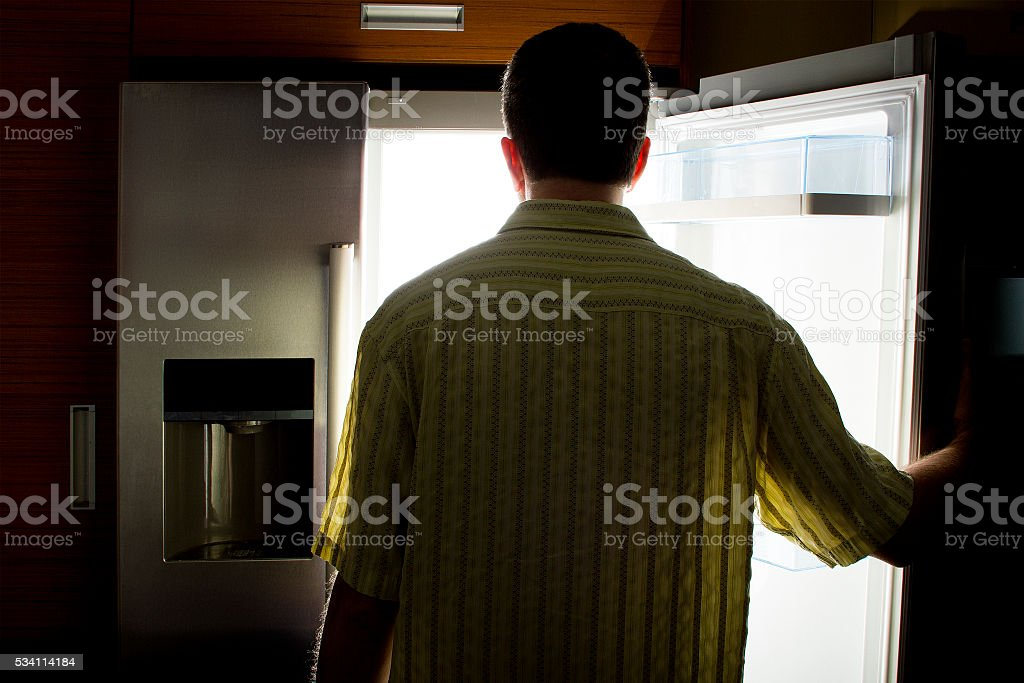 Bachelor Looking For Food in a Fridge stock photo