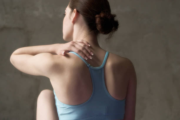 back ache massage Back ache massage after a workout human neck stock pictures, royalty-free photos & images