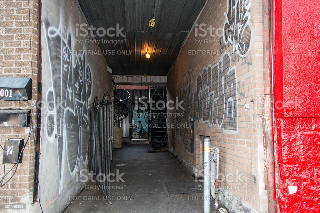 Back alley leading to a speakeasy bar stock photo