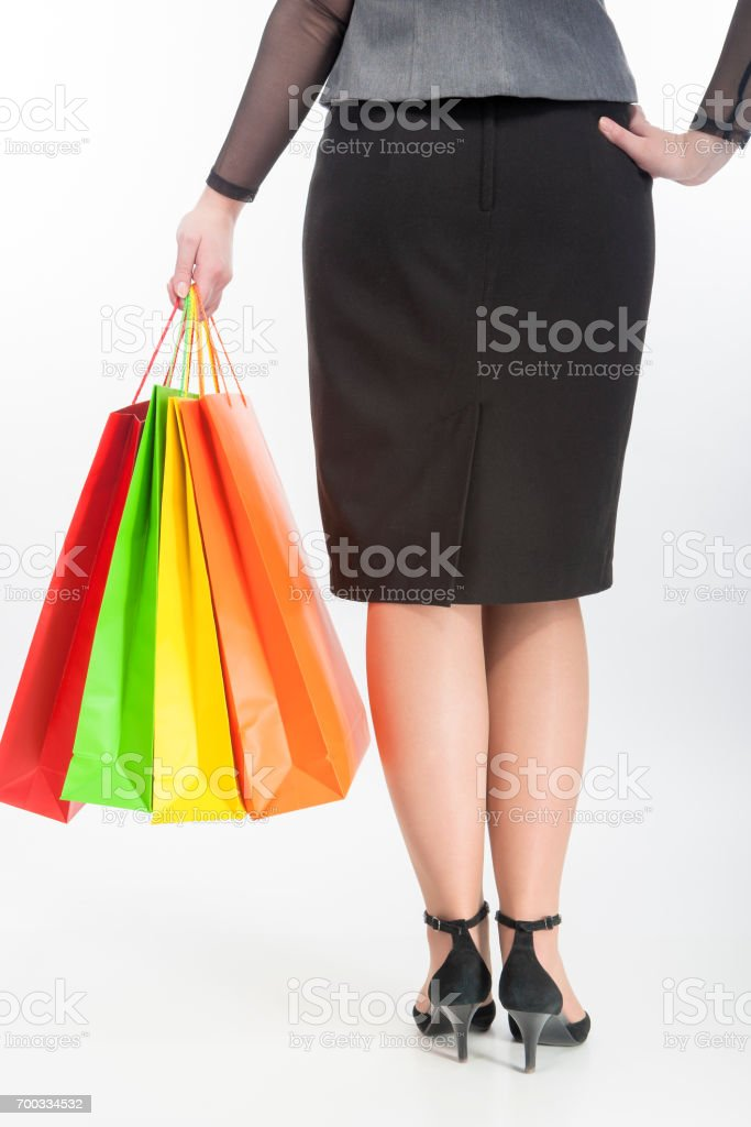 Back Closeup View of Woman Holding Shopping Color Bags. stock photo