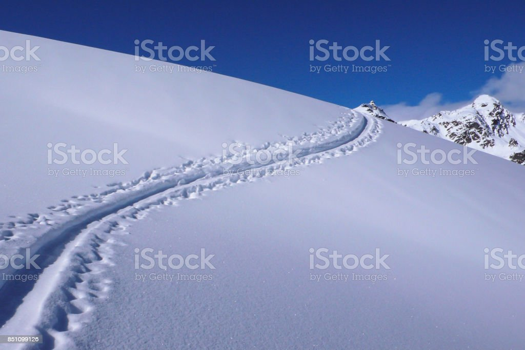 back country ski track first line in Switzerland in the Alps stock photo
