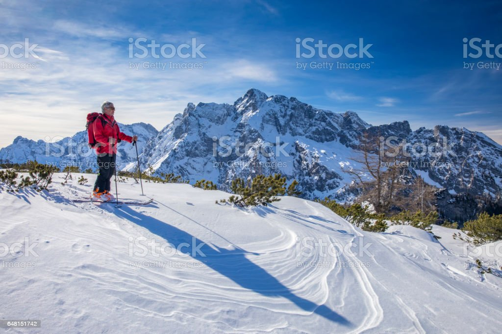 Back country skier at Watzmann with Hochkalter in Background- Alps stock photo