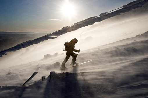 istock Back country skier climbing a mountain in a severe storm. 910616072