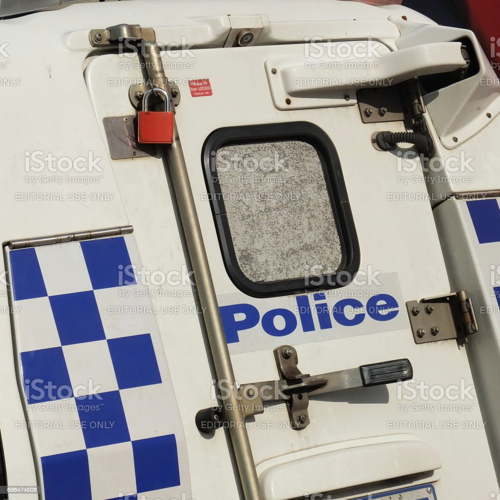 Back door of a police car with locks and sign of the Victorian Police stock photo