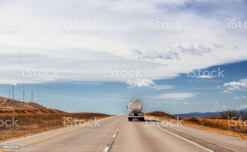 Back end of oil tanker on interstate stock photo