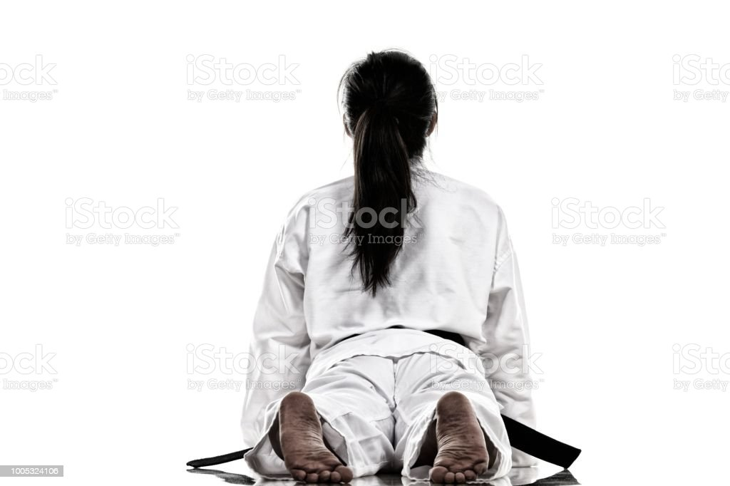 Martial artist stretching her back.