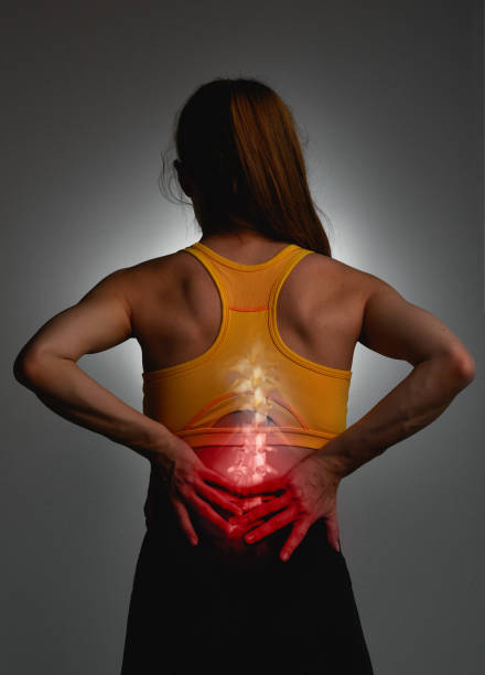 Back hurting so much during workout stock photo