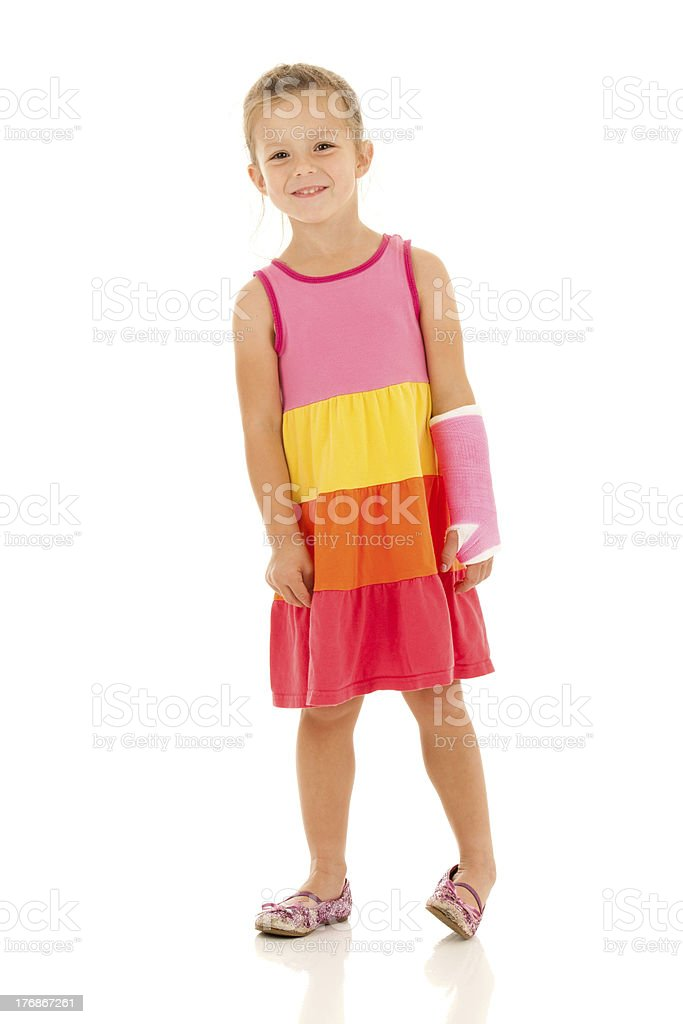Back in Action! Smiling Girl with Cast on Broken Arm stock photo