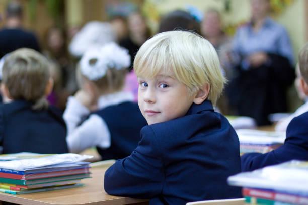 back in school - boy in the classroom - scolaro foto e immagini stock