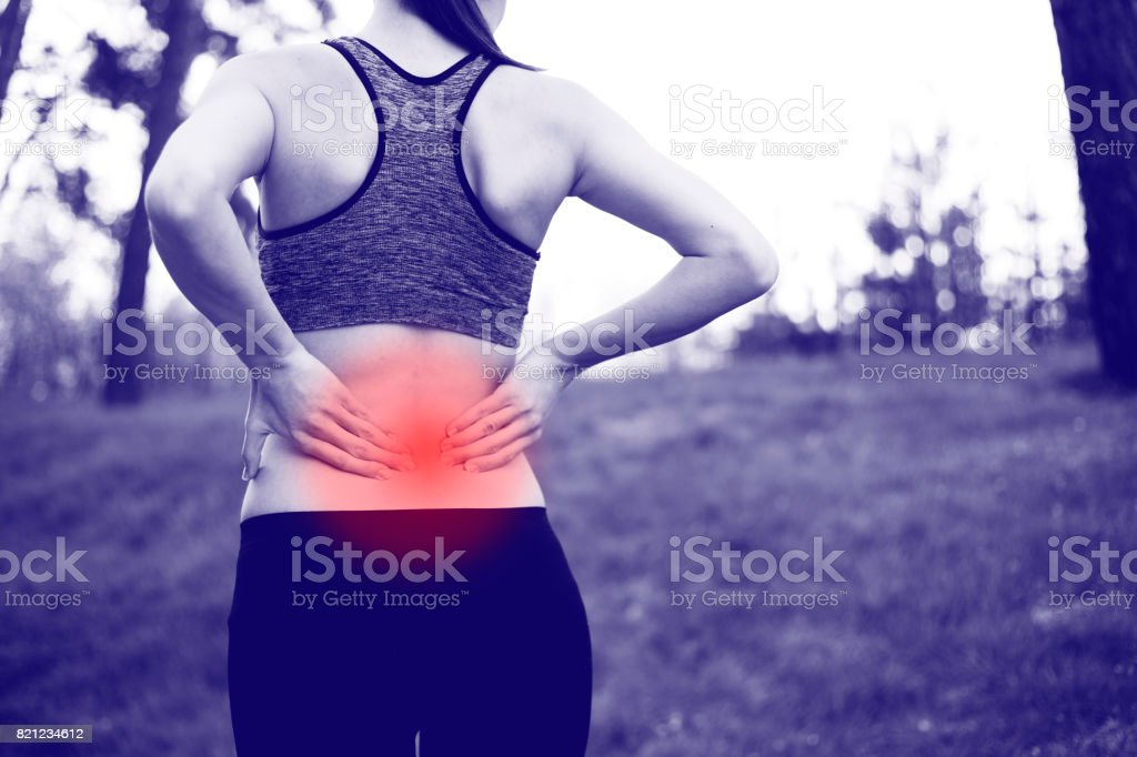 Back injury in training stock photo