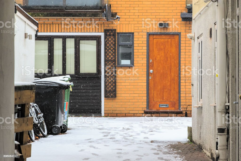 Back lane covered by winter snow in London stock photo