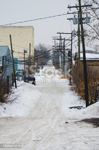 istock Back lane in winter in Winnipeg, Manitoba 1303421213