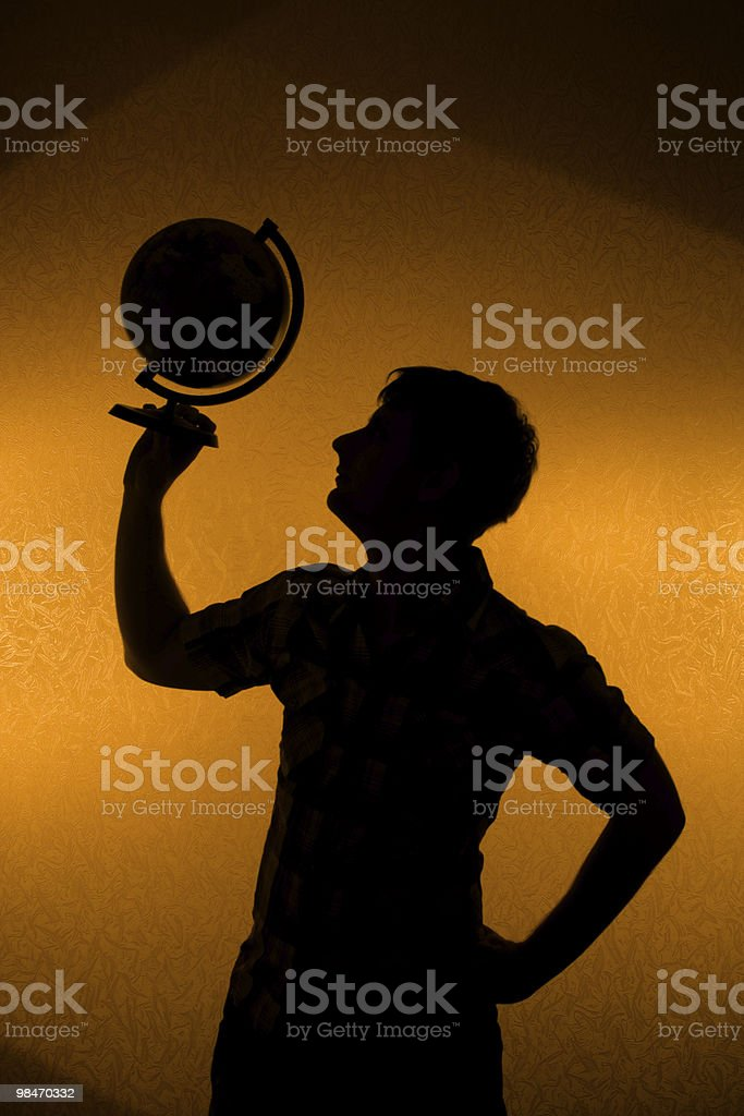 Back light - silhouette of man holding globe royalty-free stock photo