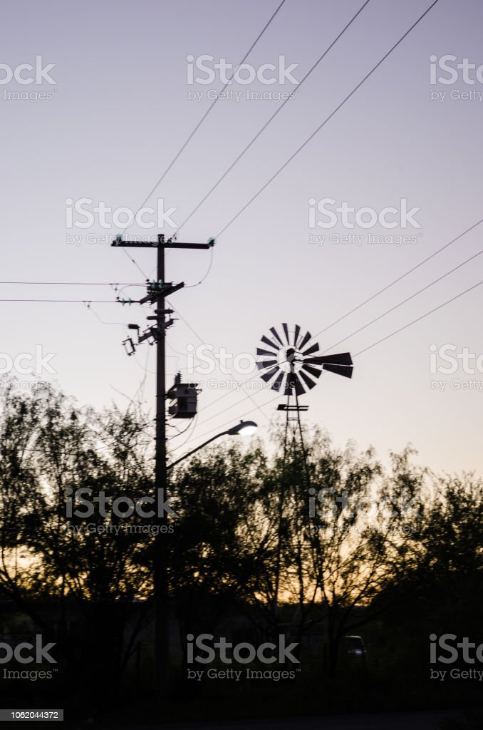 Back light windmill, shadow of a mill next to a lamppost, in the...