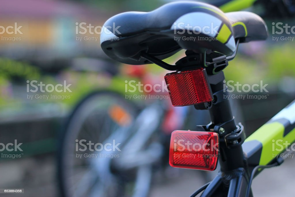Back lights bicycle on street background stock photo