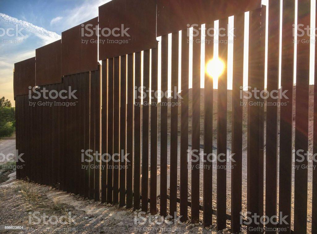 Back lit border fence stock photo