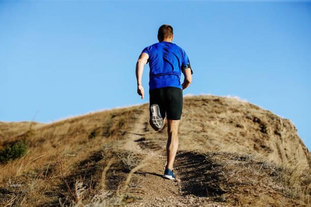 corredor masculino de vuelta carrera - foto de stock