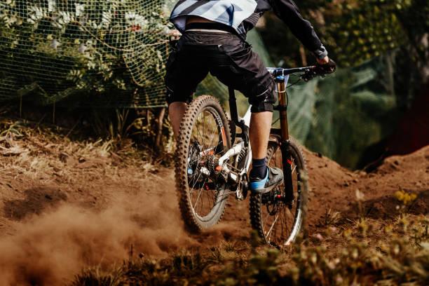 back man rider downhill mountain biking - mountain biking stock photos and pictures