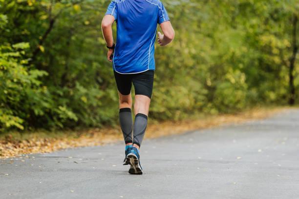 Back Man corredor corriendo - foto de stock