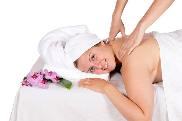 Back massage at day spa by masseuse stock photo