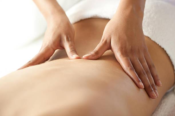 Back massage at spa stock photo