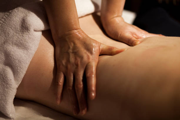 back massage detail - thai massage stock photos and pictures
